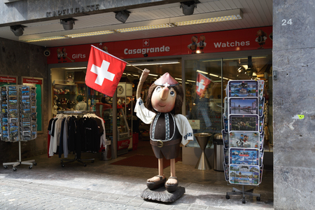 advertises: LUCERNE, SWITZERLAND - MAY 2, 2016: Casi Boy, mascot created in 1959 advertises Casagrande gift store belonging to the created in 1948 the company, that since 1950 sells souvenirs known among tourists