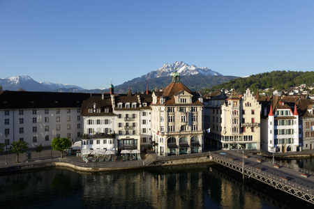 townhouses: LUCERNE, SWITZERLAND - MAY 05, 2016: Old colorful  buildings by the river shows unique character of Old Town and it looks to be tuned with modern times and offers variety of sightseeing attractions Editorial