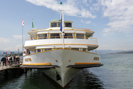 buit in: RAPPERSWIL, SWITZERLAND - MAY 10, 2016: Motor ship was buit in 1964 is moored at the ferry terminal in Rapperswil. It was named Helvetia that is the female national personification of Switzerland Editorial
