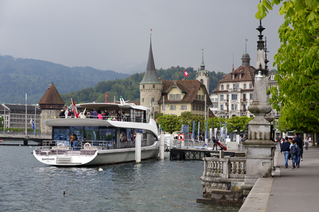 ms: LUCERNE, SWITZERLAND - MAY 03, 2016: The city seen from the Lake Lucerne. At the ferry terminal MS Saphir is moored. It is elegant Panorama-Yacht that offers breathtaking tours of the lake