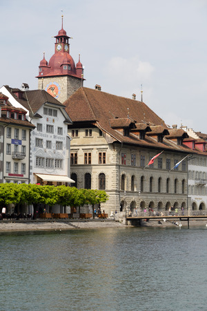 LUCERNE, SWITZERLAND - MAY 02, 2016: Town Hall was built in the early 1600s, it is impresive building together with its tower is located down by the river Reuss.