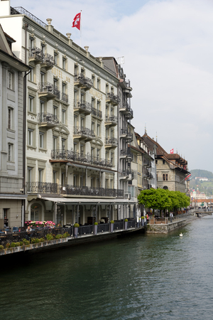 townhouses: LUCERNE, SWITZERLAND - MAY 02, 2016: Townhouses along the river Reuss shows the unique character of the city and variety of sightseeing attractions. The town is a destination for many travelers Editorial