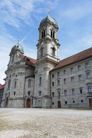 hermits: EINSIEDELN, SWITZERLAND - MAY 09, 2016: Front facade of Benedictine Abbey that is dedicated to Our Lady of the Hermits, it is a part of  the monastery complex and is located in the Canton of Schwyz Editorial