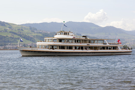 RAPPERSWIL, SWITZERLAND - MAY 10, 2016: MS Helvetia vessel arrives from Zurich to Rapperswill Ferry Terminal. The name Helvetia expresses the female national personification of Switzerland Editorial