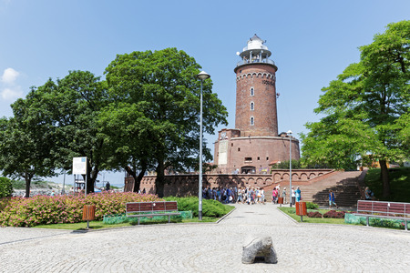 KOLOBRZEG, POLAND - JUNE 22, 2016: Massive building of the lighthouse as seen from the land side. This is one of the most recognizable and most visited tourist attractions in the city.