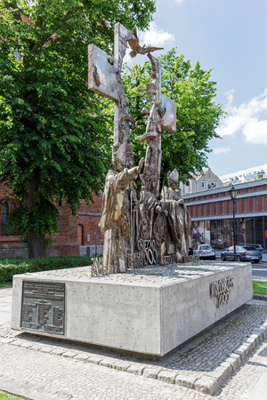 enlarged: KOLOBRZEG, POLAND - JUNE 23, 2016: Millennium Memorial that was made of stainless steel and it was unveiled in 2000 years then enlarged in 2008, it is located next to Basilica in downtown
