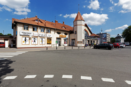 railway points: KOLOBRZEG, POLAND - JUNE 23, 2016: Railway station building that was officially opened on June 01, 1859. In the building they are established several retail points Editorial