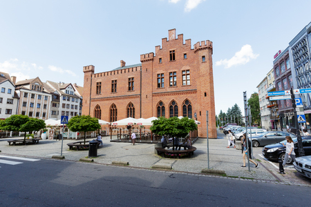 remodeled: KOLOBRZEG, POLAND - JUNE 23, 2016: Side view of the neo-Gothic two-storey building of City Hall that was built between 1829-1832, it was slightly remodeled in 1913 Editorial