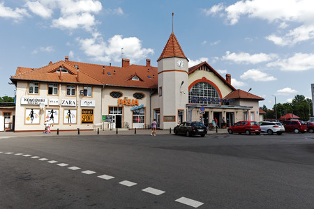 railway points: KOLOBRZEG, POLAND - JUNE 23, 2016: Railway station building which was officially opened in the year 1859. In the building they are established several retail points