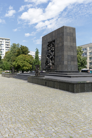 nazis: WARSAW, POLAND - AUGUST 05, 2016: Ghetto Heroes Monument that commemorates the heroes who fought against the Nazis during the uprising in 1943 and is next to the Museum of the History of Polish Jews Editorial