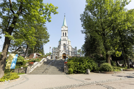 pius: ZAKOPANE, POLAND - SEPTEMBER 12, 2016: Holy Family Church that was built in 1879-1896 in the Romanesque Revival style by architect Jozef Pius Dziekonski