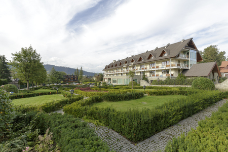 ZAKOPANE, POLAND - SEPTEMBER 23, 2016: Hotel Wersal that is located in a modern building with architecture reminiscent of the style of the region is surrounded by a beautiful garden providing peace Editorial