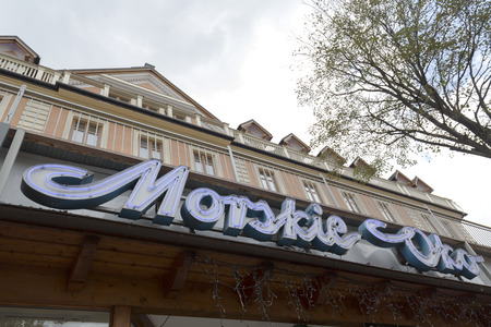 oko: ZAKOPANE, POLAND - SEPTEMBER 20, 2016: Lettering Morskie Oko refers to name of one of the old hotels in the city that was built of wood and after a fire in 1899 was rebuilt in 1901 as a brick building