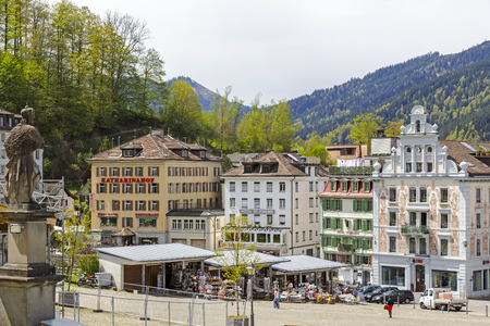 general store: EINSIEDELN, SWITZERLAND - MAY 09, 2016: Colorful buildings of the city and stalls in which variety of souvenirs are put on sale. The town is widely known because of Einsiedeln Abbey