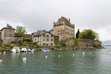 Yvoire, France - May 24, 2013: Medieval castle that is beautifully situated on the shore of Lake Geneva. Other stone houses in the immediate vicinity complement the impression that time has stopped here. Editorial