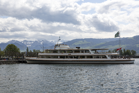 Rapperswil, Switzerland - May 10, 2016: MS Helvetia moored at the ferry terminal by the shore of Lake Zurich. The vessel was named Helvetia that is the female national personification of Switzerland