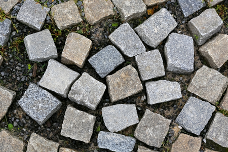 The surface of the pavement needs to be repaired because granite blocks do not lie with each other.