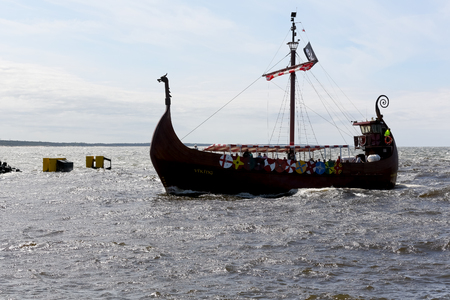 Kolobrzeg, Poland - June 20, 2017: Stylized ship called Viking returns from a cruise. The ship is seen in the rough waters of the Baltic Sea as it enters the sea port