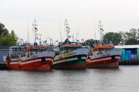 Kolobrzeg, Poland - June 15, 2017: Trawlers in the sea port are moored along the wharf. Editorial
