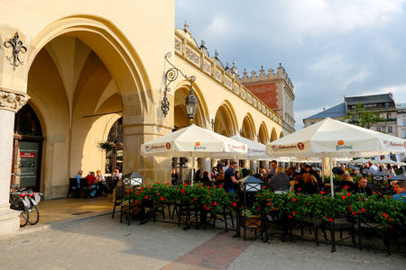 Krakow, Poland - May 25, 2017: Restaurant is located in an open air in the old town square by the Cloth Hall . There are people who can be seen Editorial