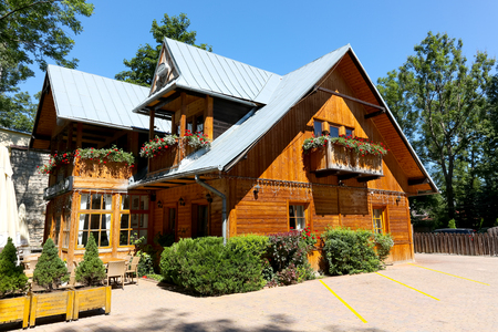Zakopane, Poland  August 08, 2017: Historical house built of wood in 1888 formerly was called Anielowka. Nowadays it houses restaurant which is named The Little Switzerland.