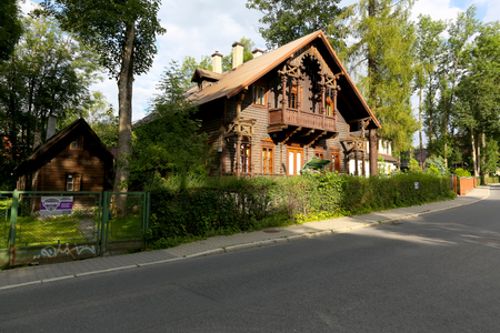 Zakopane, Poland - August 15, 2017: Villa made of wood is named Grabowka III. The house was built in Tyrolean style in the second half ot the nineteenth century Editorial