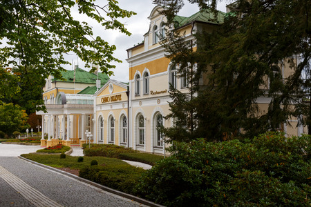 Marianske Lazne, Czechia - September 12, 2017: Beautiful building that houses the casino dates back to the first half of nineteen century and it looks as if it wanted to hide among the greenery 報道画像