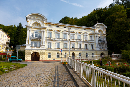 Marianske Lazne, Czechia - September 09, 2017: The townhouse in sunlight shows its beautiful architectural elements decorating the front facade of this well preserved architectural treasure