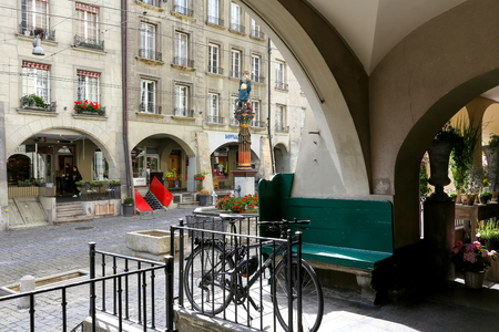 Bern, Switzerland - September 18, 2017: Many buildings in this city got arcades that reach a total length of several kilometres. Here arcades on the other side of the street can be seen