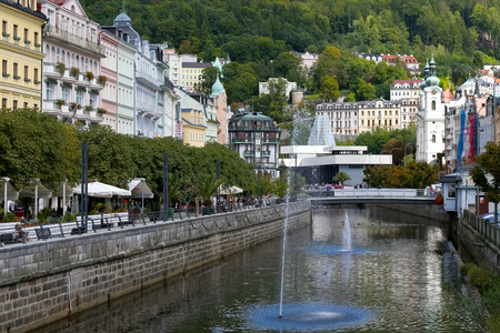 Karlovy Vary, Czechia - September 11, 2017: Cityscape discovers the beautiful architecture, the Tepla River and the forests in a short distance, which emphasizes the spa character of this resort.