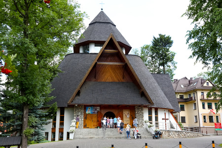 Zakopane, Poland - August 15, 2017: The Church of Divine Mercy, built in 1994, is seen on a cloudy day. There are a few believers in front of the church. Editorial