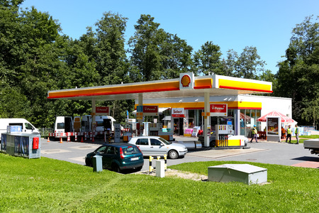 Zakopane, Poland  August 08, 2017: The gas station belonging to a global group of oil and gas the Shell group. Around it is a lawn and many trees that can suggest green energy.