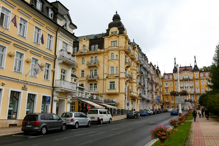 Marianske Lazne, Czechia - September 10, 2017: Architecture of this spa town is seen just by the street on which there are a few cars parked