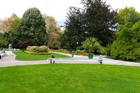 Karlovy Vary, Czechia - September 11, 2017: The green areas of the Dvorak Park in the city centre are designed to ensure direct contact with nature for residents and tourists.