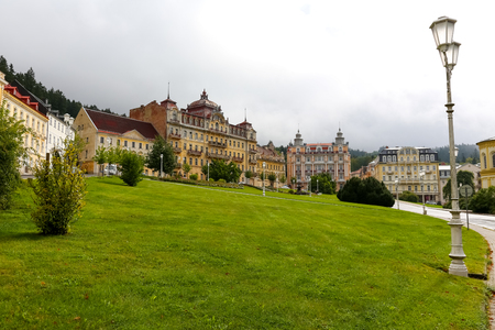 Marianske Lazne, Czechia - September 10, 2017: Goethe square with its beautiful hotel buildings and the dominant former building of the Weimar Hotel which looks as if it was abandoned. Redakční