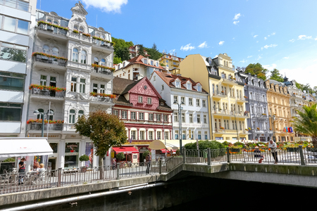 Karlovy Vary, Czechia - September 11, 2017: Many of the beautiful tenement houses with colorful facades can be admired along the banks of the Tepla River.