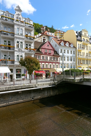 Karlovy Vary, Czechia - September 11, 2017: Tenement houses by the river Tepla. The multitude and variety of colourful tenement houses is one and the tourist attractions of this resort.