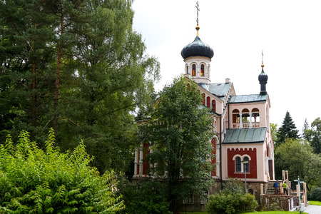 Marianske Lazne, Czechia - September 10, 2017: Orthodox Church of St Vladimir was built for the Russian spa guests early of the twentieth century and looks as if it emerged from among trees.