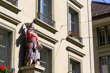 Bern, Switzerland - September 25, 2017: The statue of the butcher decorates frontage of a building in the old town.