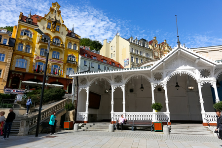 Karlovy Vary, Czechia - September 11, 2017: The white pavilion of the Market Colonnade can be admired against the background of the colourful tenement houses of this spa town. Editorial