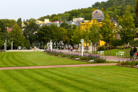 Marianske Lazne, Czechia - September 09, 2017: The wide lawn with flowers separates the park alleys one to each other. This makes for guests who have come here to enjoy direct contact with nature.