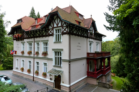 Marianske Lazne, Czechia - September 12, 2017: The relatively simple structure of the building is decorated with a decorative roof with many slopes that is covered with ceramic tiles.