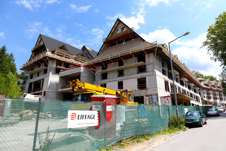 Zakopane, Poland - August 15, 2017: Construction site and large buildings that still require a lot of finishing work to become a beautiful hotel. Editorial