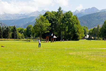 Zakopane, Poland - August 08, 2017: Green areas and mountains in Zakopane. This is a view from the city park, which is called the Rowien Krupowa by the names of former landowners.