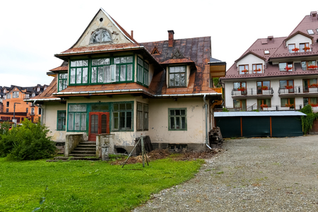 Zakopane, Poland - August 07, 2017: The old house is built from about 1910 and seems to be slowly renovated. It is a traditional style house in the region. Editöryel