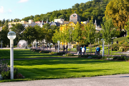 Marianske Lazne, Czechia - September 11, 2017: People benefit from the sunny weather in a public park that is close to the colonnades and fountains and mineral waters accessible to the spa guests. Editorial