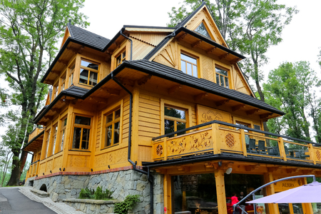 Zakopane, Poland - August 06, 2017: The wooden house is beautifully restored and expanded. The building dates back to the early 20th century and now houses a restaurant.