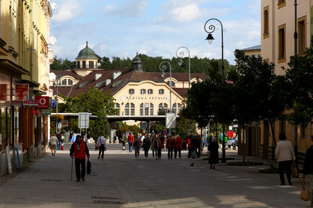 Karlovy Vary, Czechia - September 11, 2017: In a distance there is a building with a modern self-service shop. Previously, it was a Market Hall and its history goes back a long way in the past.