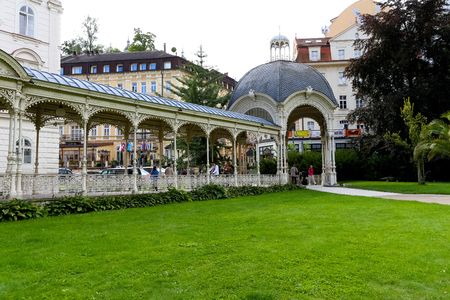 Karlovy Vary, Czechia - September 11, 2017: Beautiful Park Colonnade, which is located in Dvorak Park is one of many architectural pearls in this spa town. There are people admiring this place. Editorial