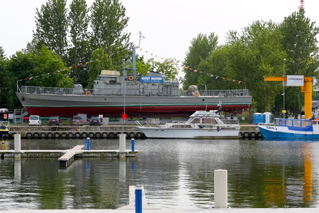 Kolobrzeg, Poland - June 15, 2017: Patrol ship, which was withdrawn from service in 1996, is now exposed on the shore and serves as a museum and is accessible to visitors.